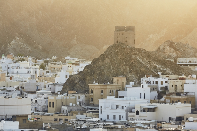 Cityscape view of Muscat city at sunset